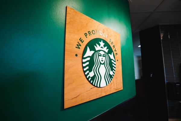 Starbucks sign on a green wall at InnJoy Cafe.