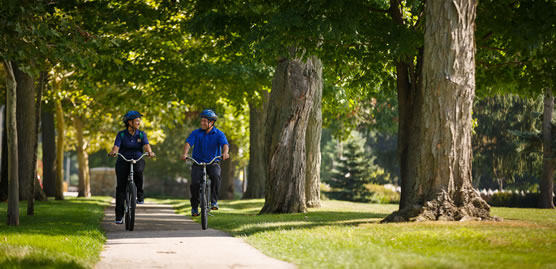 A man and woman riding bikes on a trail in South Bend, Indiana.
